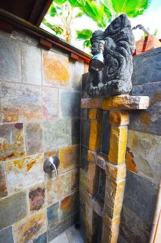 View of shower in outdoor bathroom of TIki Moon Villas