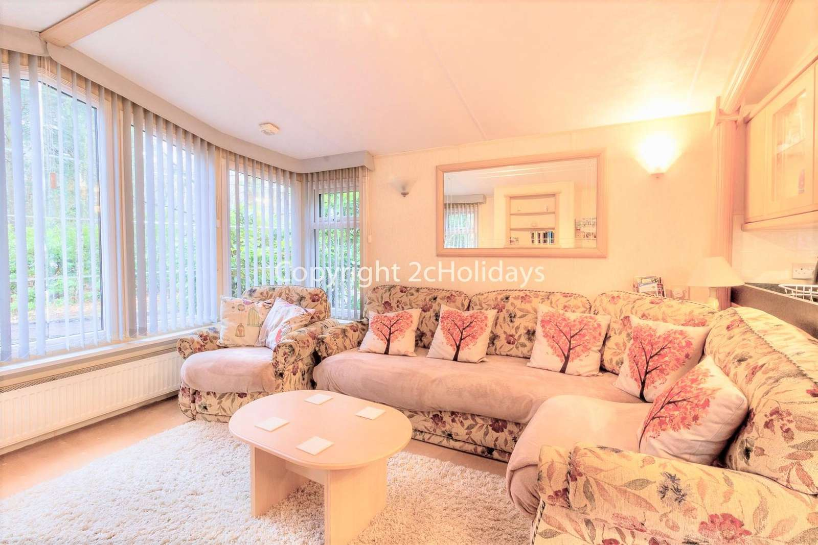 A cosy and homely living area with a TV/DVD player, ideal for families!