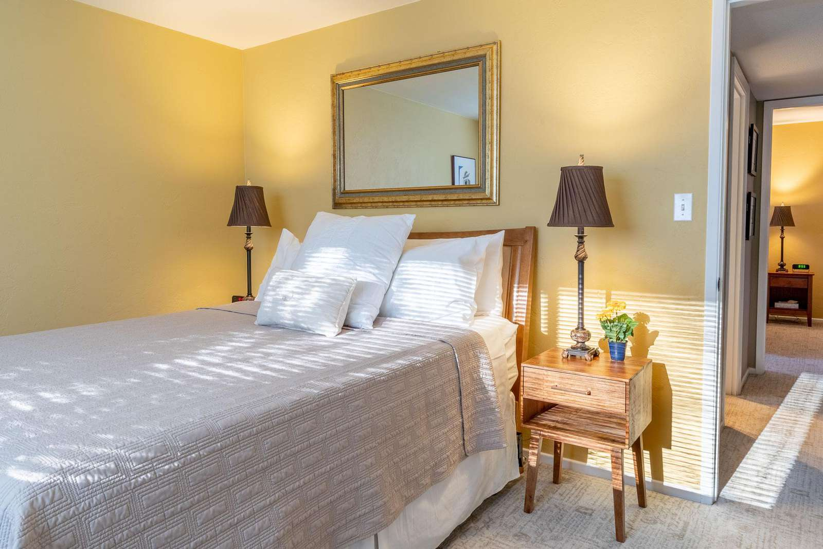 Two separate guest rooms that share a full bathroom