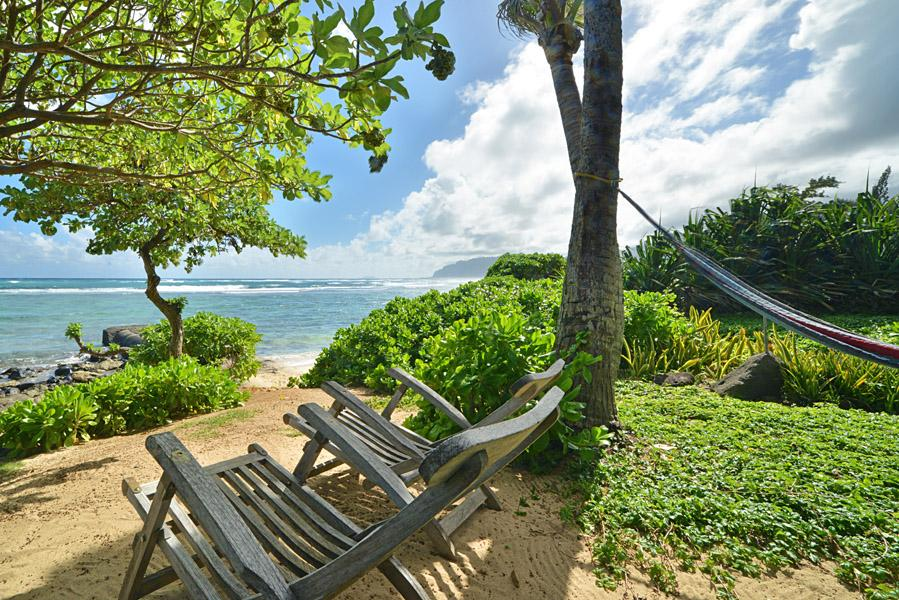 Beachside sitting area under the trees. One of the common areas for use by our guests at Tiki Moon Villas, Laie, Hawaii