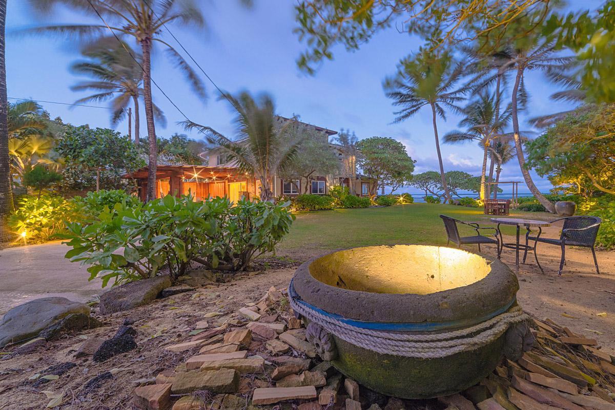 Evening view of lighting fixture in  ocean side garden of Tiki Moon Villas, Laie, Hawaii
