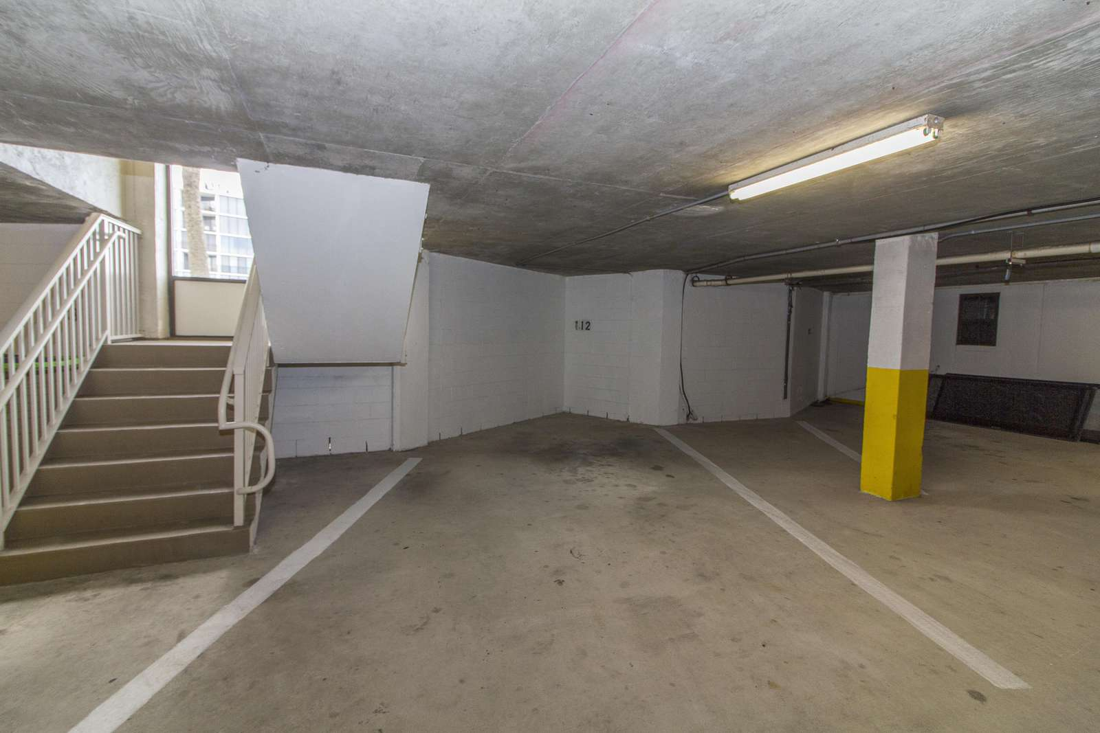 (1) Garage Parking Space + Guest Parking in Main Lot