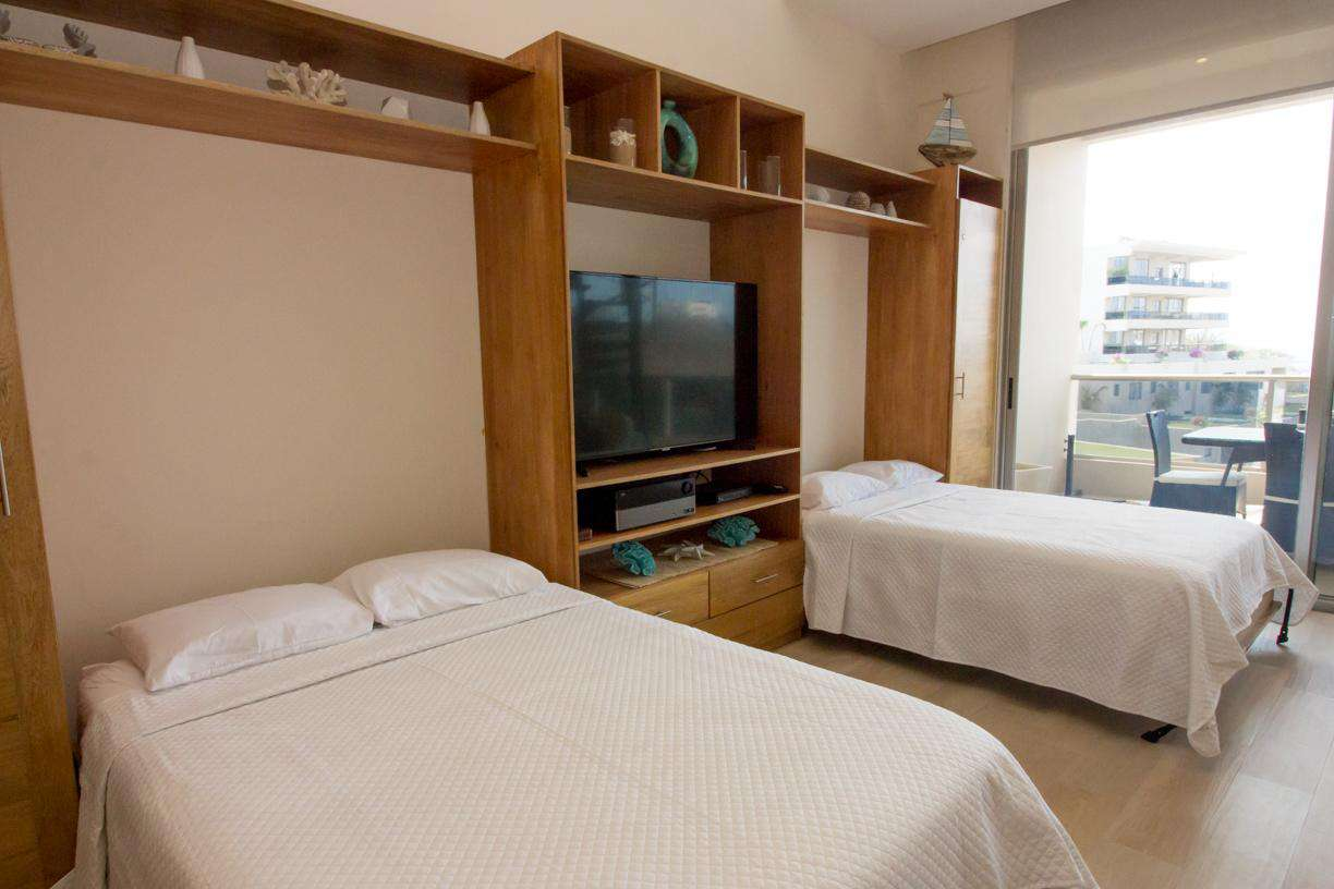 Individual size murphy beds in the living
