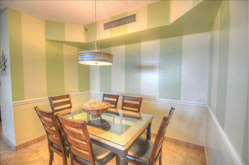 The beautiful dining area opens to the living room and has seating for 6.