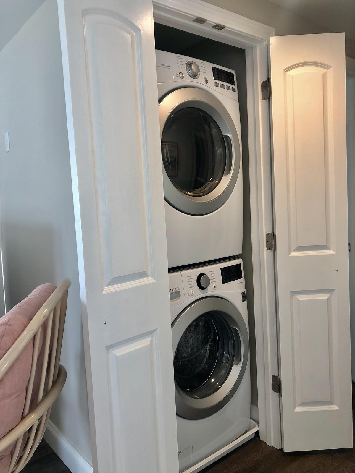 Laundry closet with full washer and dryer