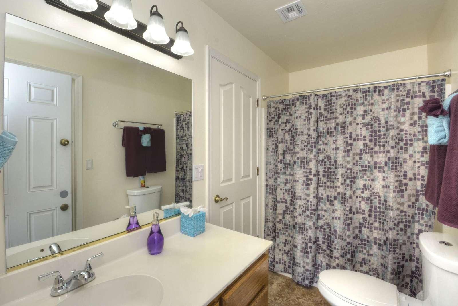 Bath en-suite with exit to pool
