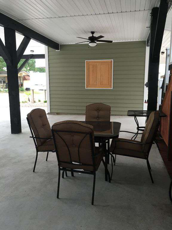 Sitting area under the house, table 4 chairs with tv