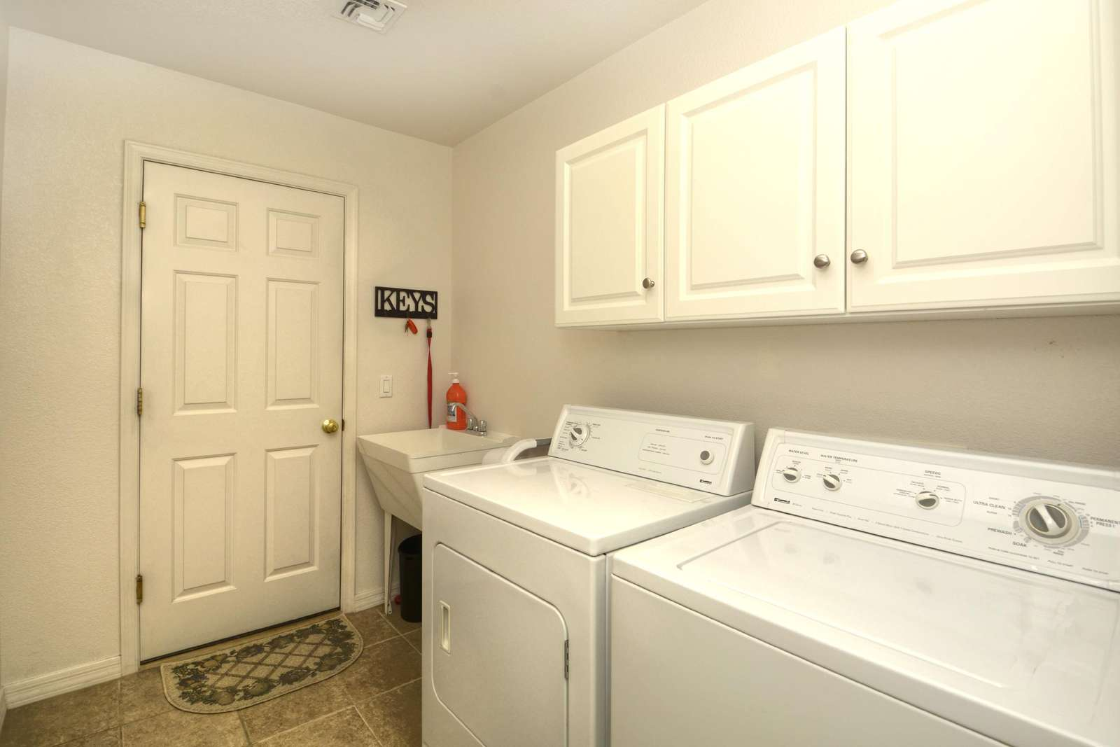 Indoor laundry with sink