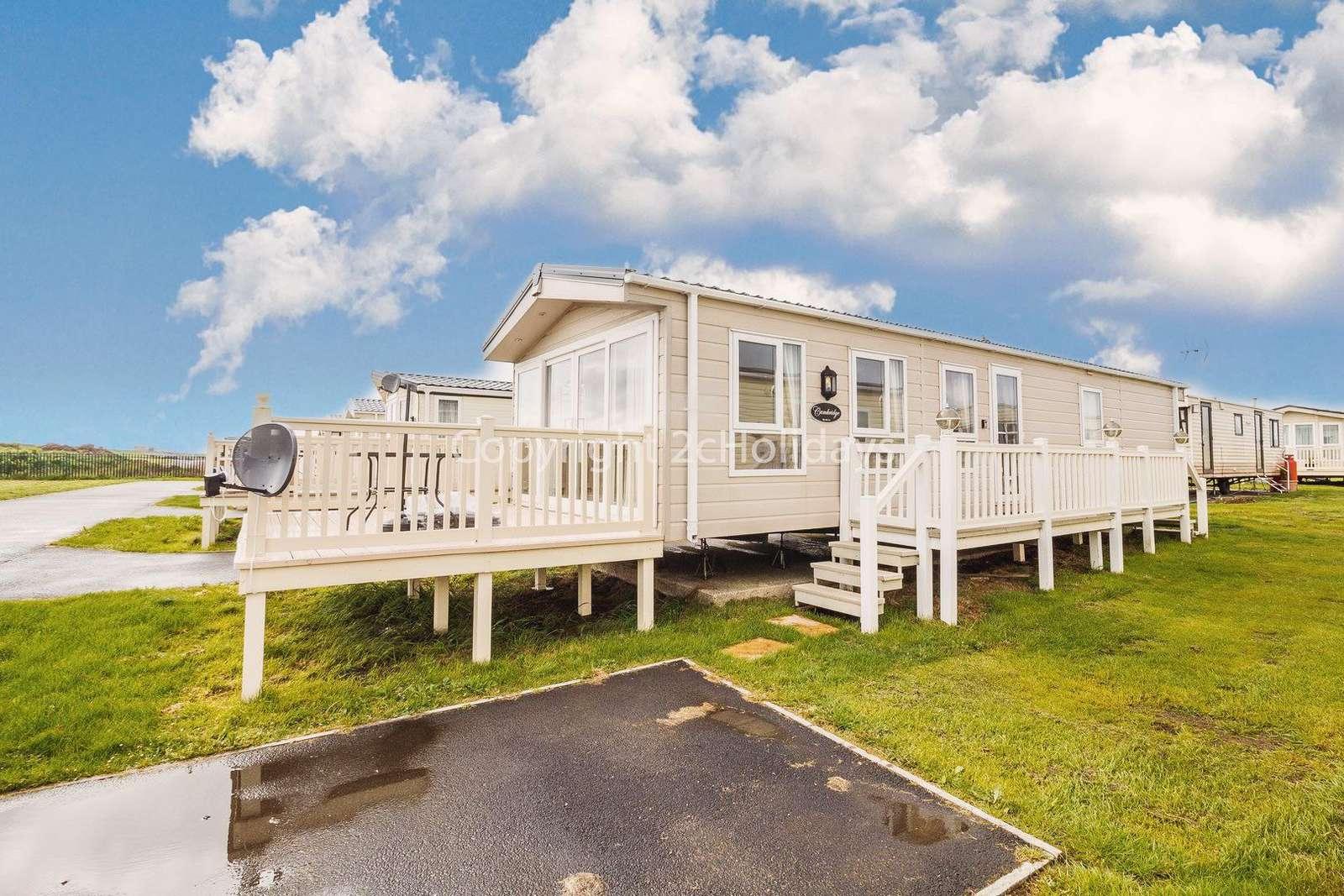 6 berth caravan with decking at St Osyth Beach Holiday Park.