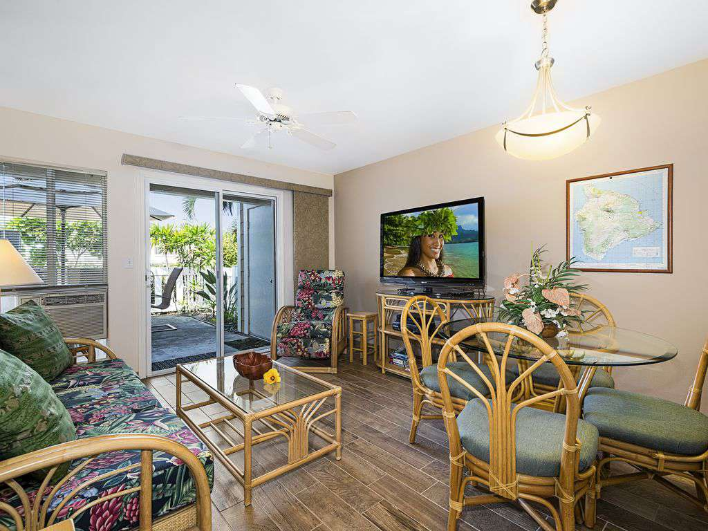 """Living area with wifi, big """"smart"""" TV, and sliders to the lanai."""