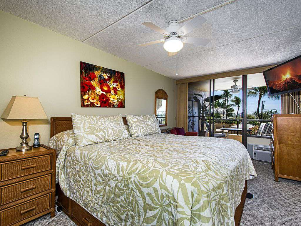 Master bedroom with lanai access, AC and private bath.