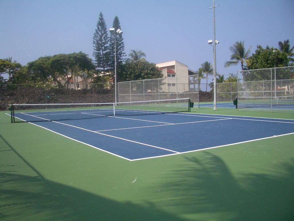 There are 3 lighted tennis courts at Surf & Racquet, new resilient surface.