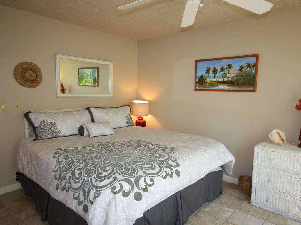 Guest bedroom with king bed and a garden view.