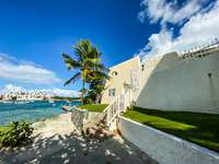 The oceanfront parking and entrance to villa. thumb