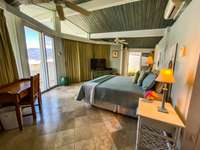 The beautiful and relaxing master bedroom suite. thumb