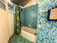 The en-suite master bath - shower/tub area. thumb