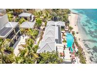 An aerial view of One Perfect Day and Little Magen's beach thumb