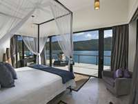 Private bedroom with exquisite views and balcony access thumb