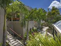 Lush, tropical landscaping all throughout the property thumb