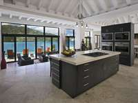Expansive and open kitchen with top-of-the-line appliances thumb