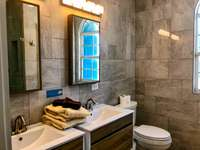 The gorgeous ensuite bath in the upstairs master suite. thumb
