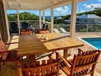 Lovely outdoor dining/sitting area - plenty of shade! thumb
