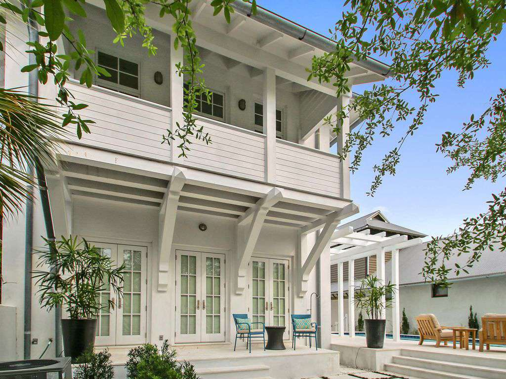 Expansive Backyard French Doors Leading to Downstairs Master