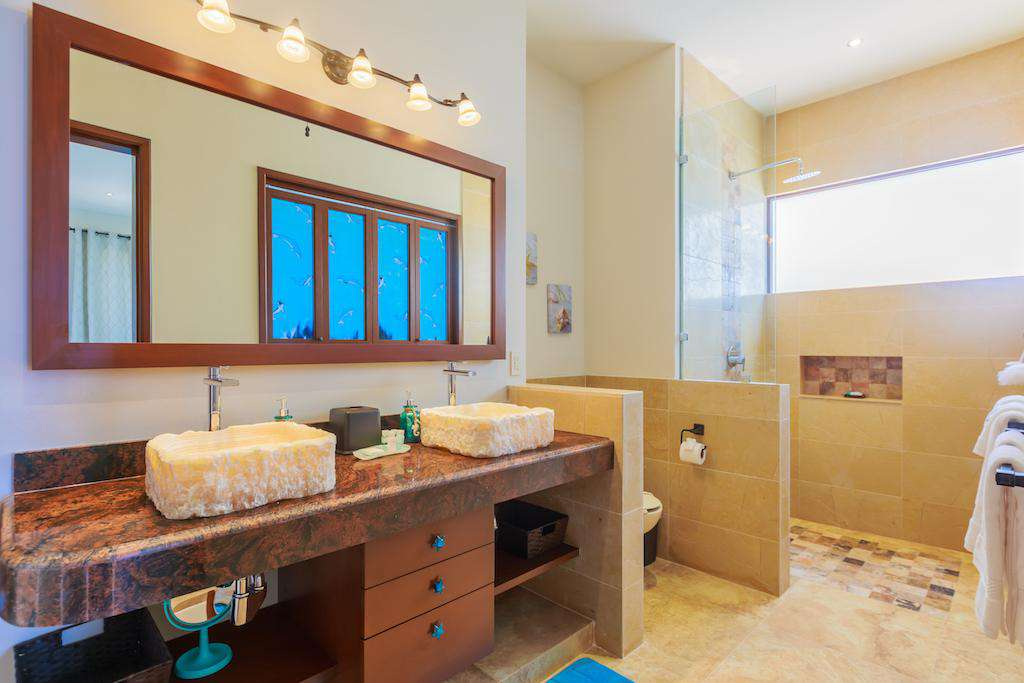 Large walk in showers and his and her sinks in each ensuite