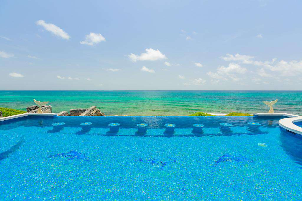 Infinity pool and stools overlooking the Caribbean