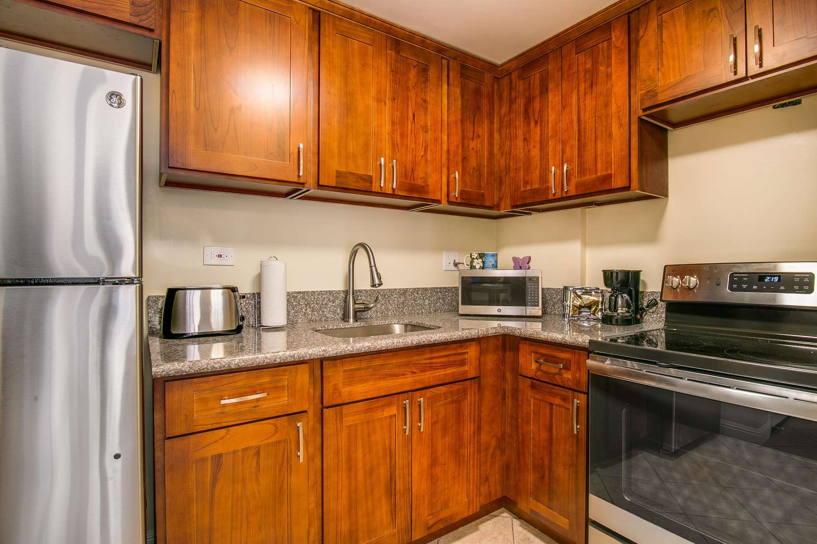Brand new kitchen with marble counters and new appliances