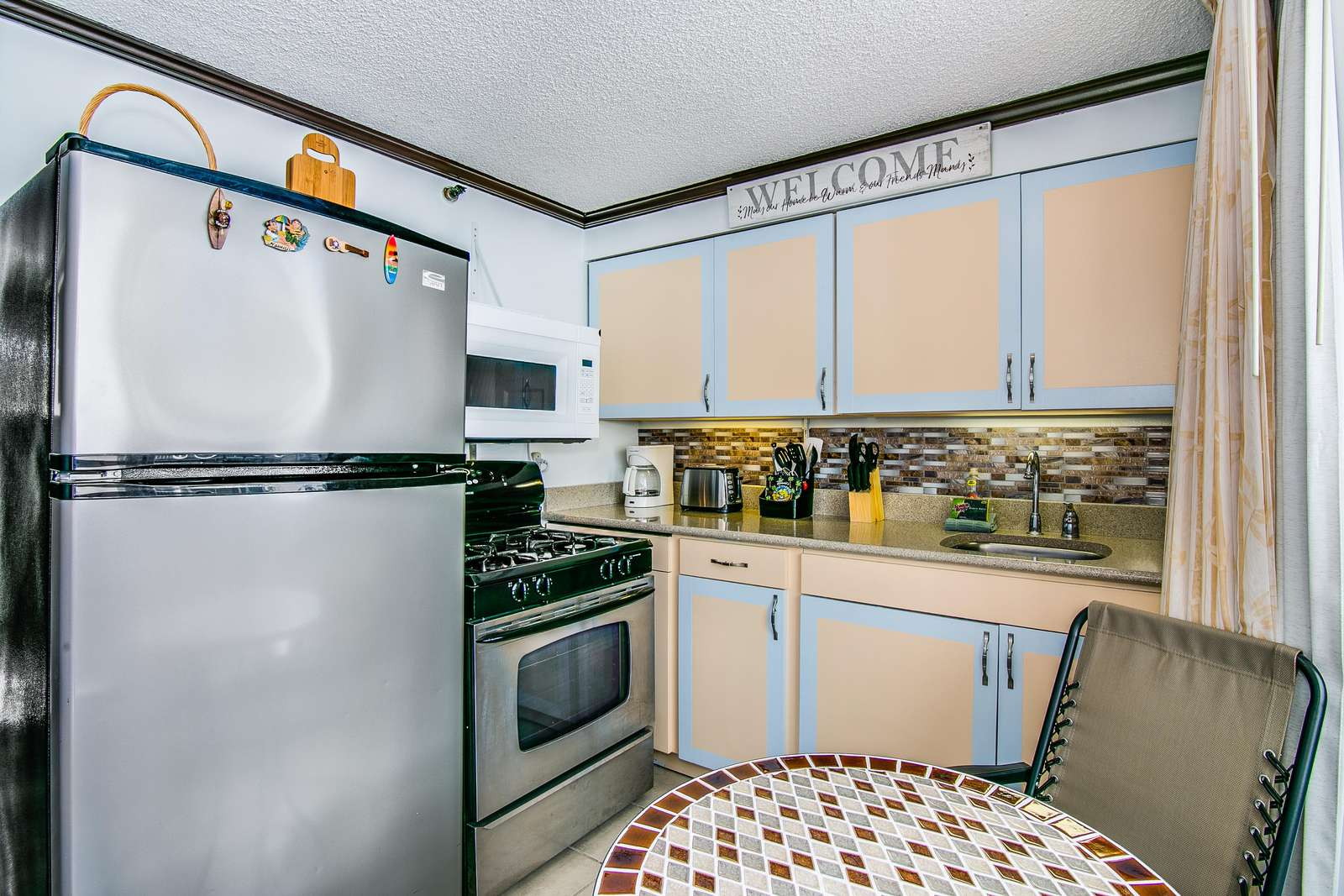 Full kitchen with large fridge and oven etc.