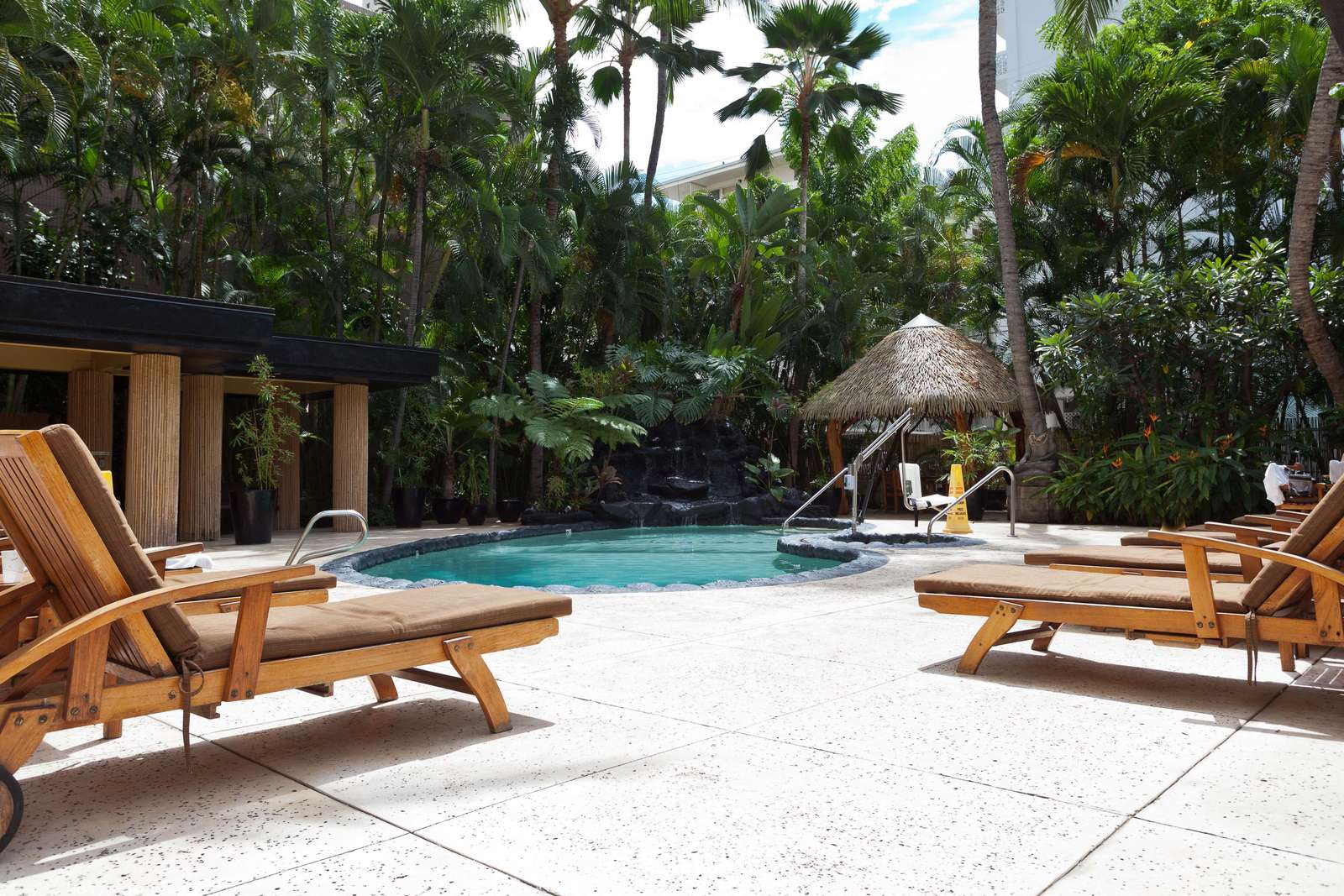 Relaxing pool deck with ample sun loungers