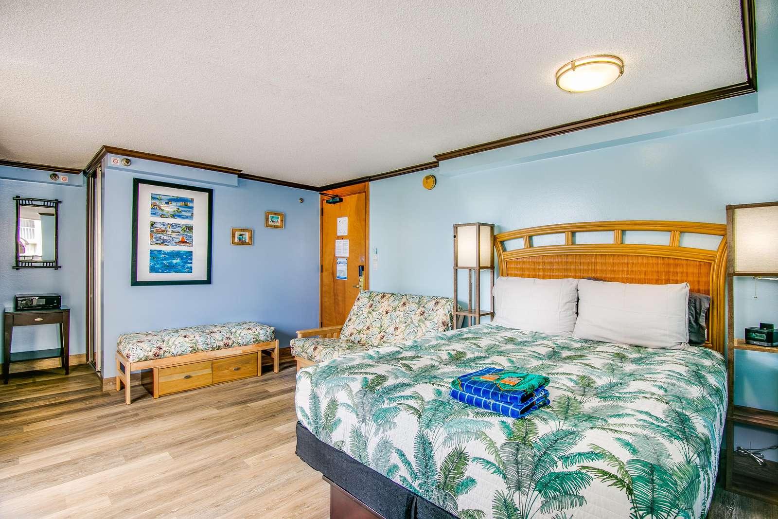 Comfortable queen mattress and new Hawaiian bedspread