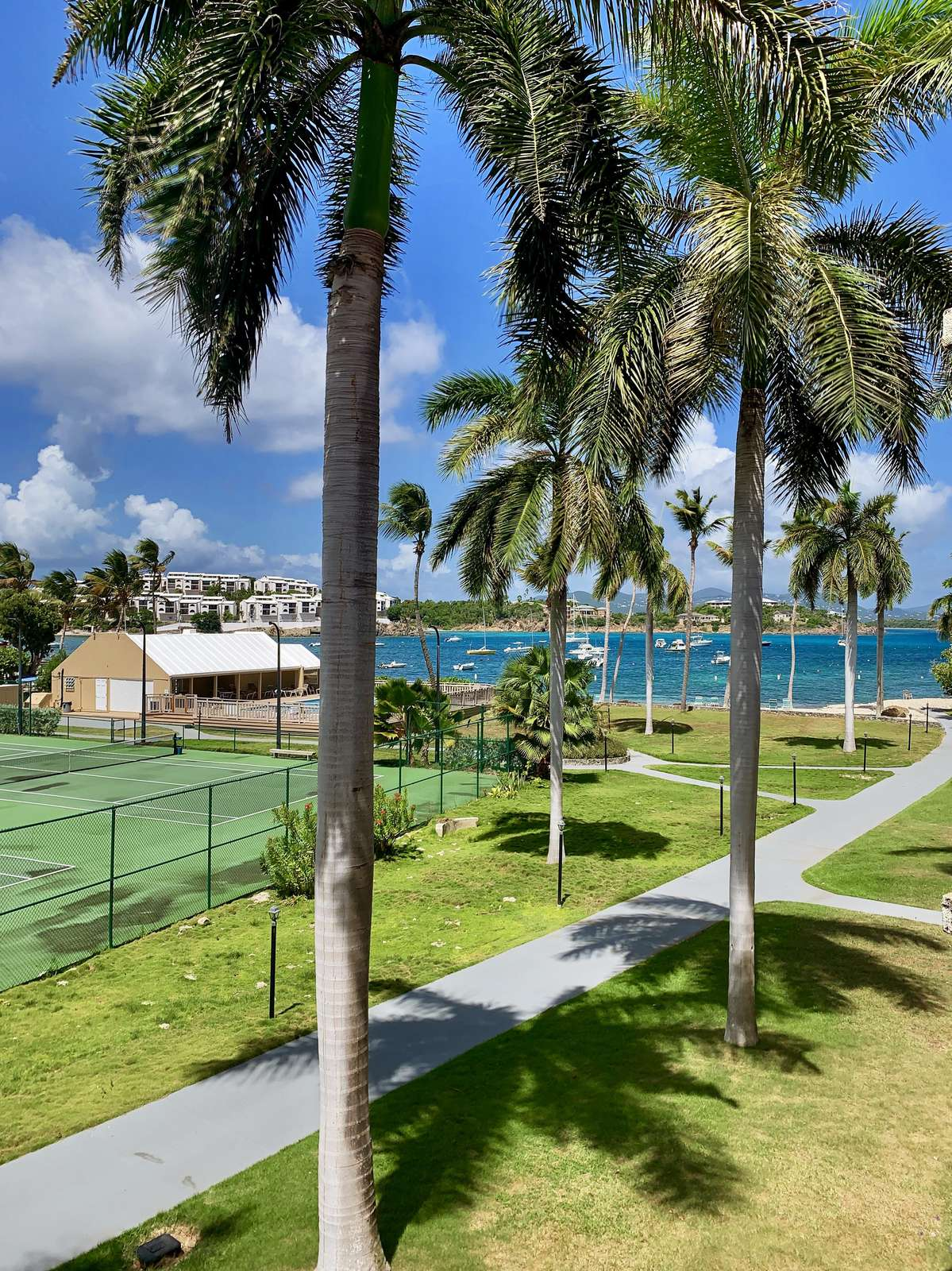 Views of the tennis court and pool