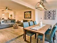 A warm neutral palette with ocean blue accents, natural elements and bleached wood flooring thumb