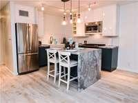 Elegant, modern kitchen with stunning center island thumb