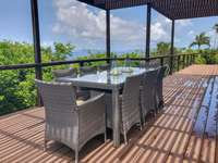 Outdoor dining with down-island views thumb
