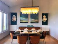 Indoor dining area with elegant lighting thumb