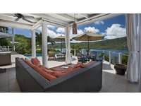 The covered veranda - with breathtaking views of Magen's Bay! thumb
