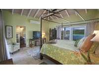 The spacious and plush master bedroom, with ensuite bath and two separate balconies!! thumb