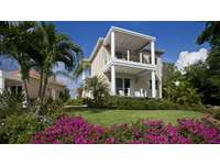 Modern caribbean style, complete with beautiful gardens! thumb