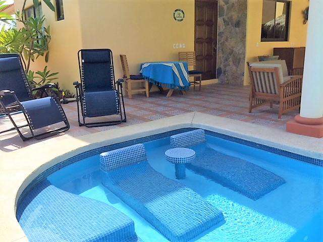 In-pool loungers & plenty of seating on the patio