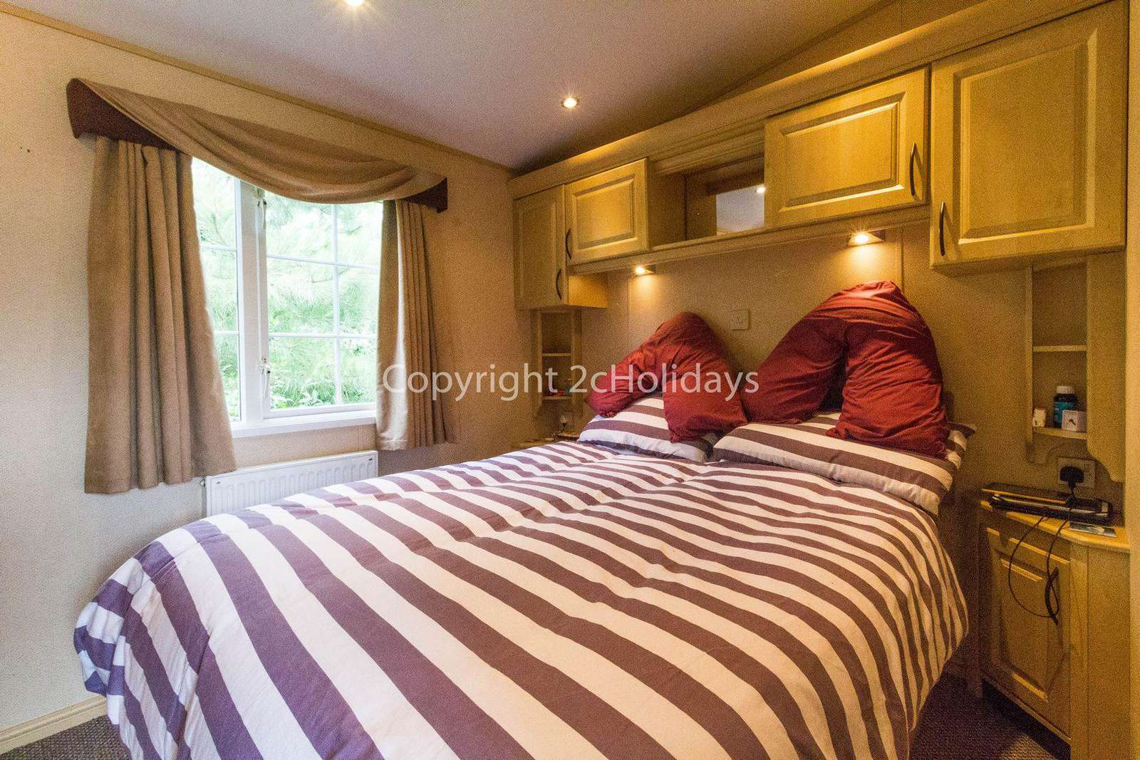 Large bedroom area in this great caravan for hire.