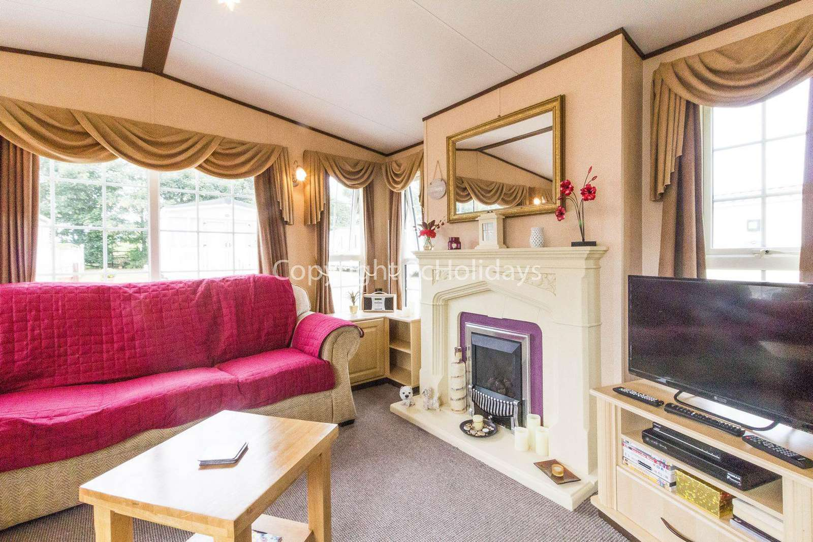 Stunning lounge in this stunning caravan for hire.