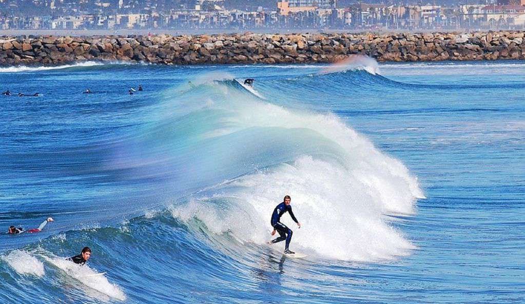 San Diego has beautiful weather and larger than normal surfing options.
