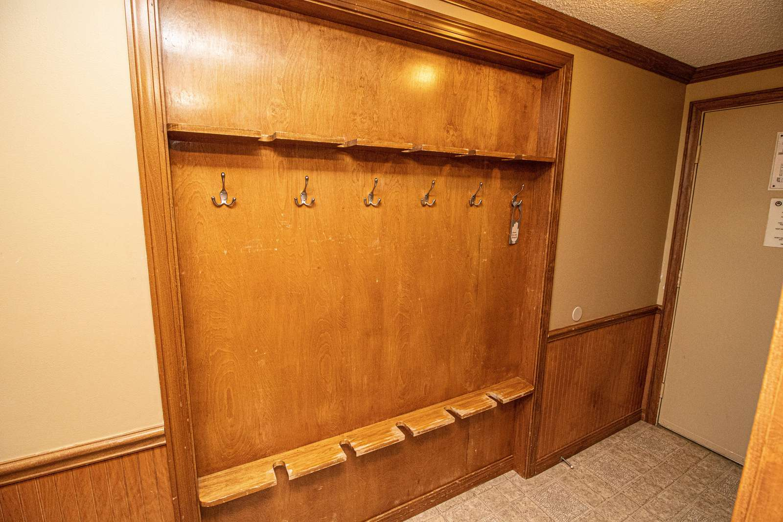 Recessed ski rack in hallway - securely store your gear inside the condo!