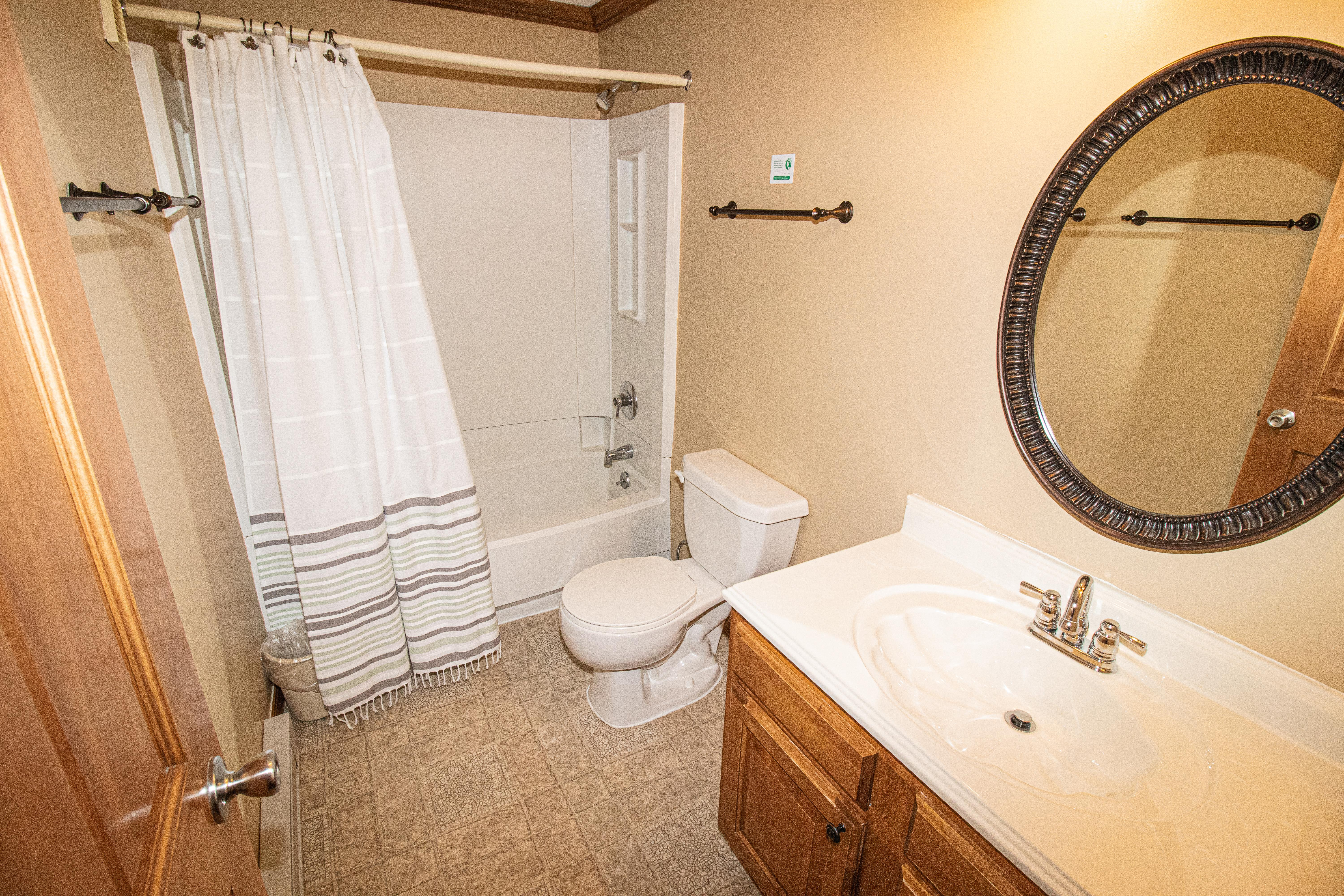 Enlarged bathroom with shower and tub. Towels provided!