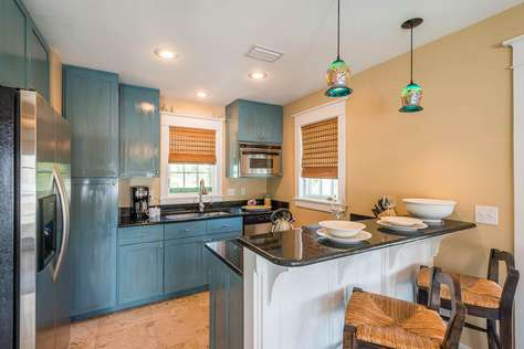 Fully Stocked kitchen with stainless steel appliances and granite countertops.