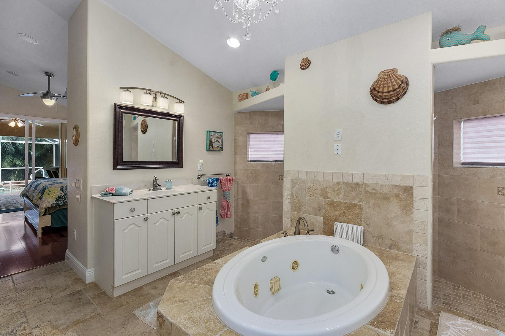Master bath with bath tub and shower