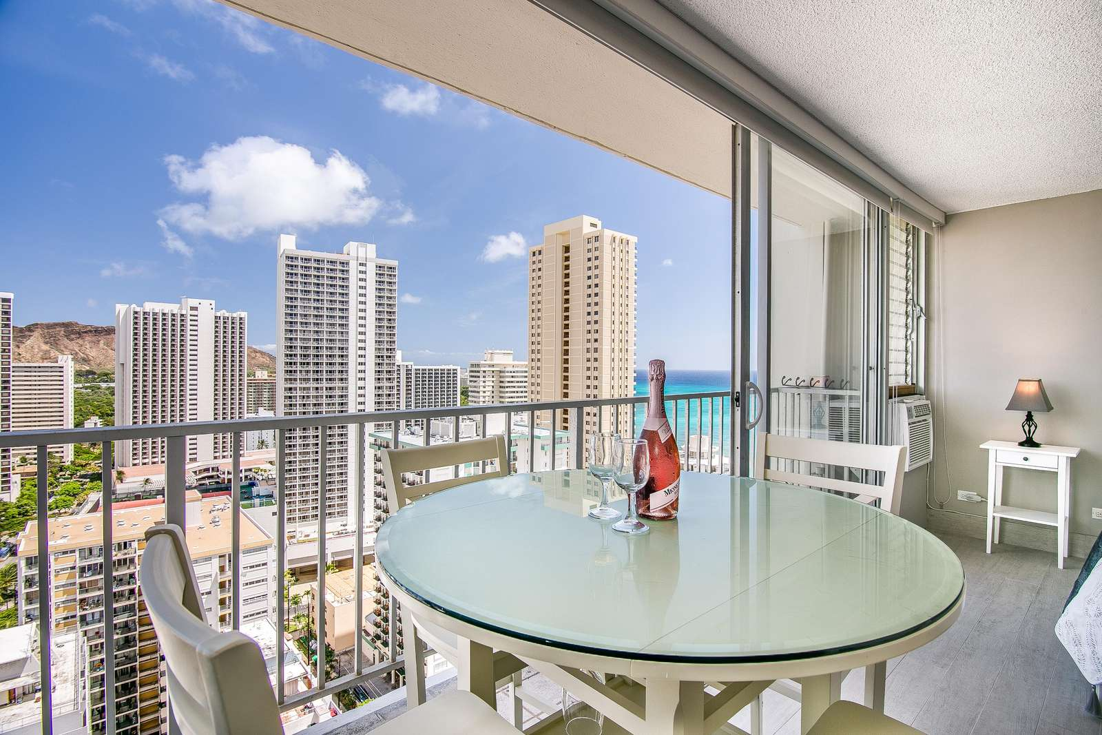 Dining area for four guests high above Waikiki